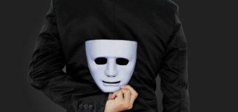 Businessman hide the mask.